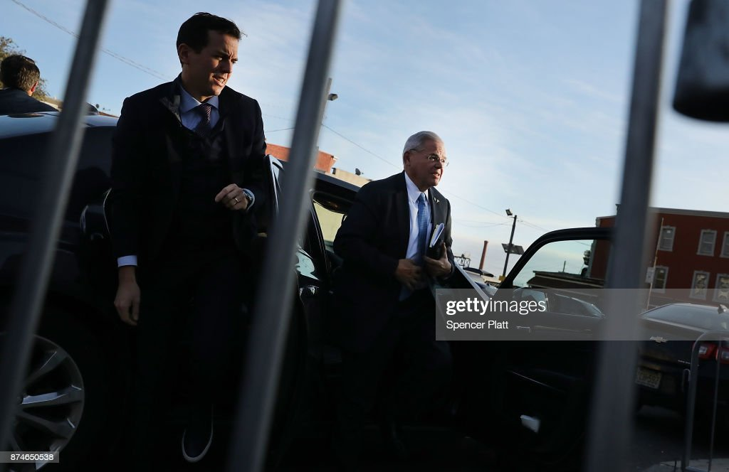 Robert 'Bob' Menendez (right) (D-NJ) walks out of his car with his son Robert Jr., as he arrives at federal court, on November 15, 2017 in Newark, New Jersey. The jury continues to deliberate in his corruption trial.