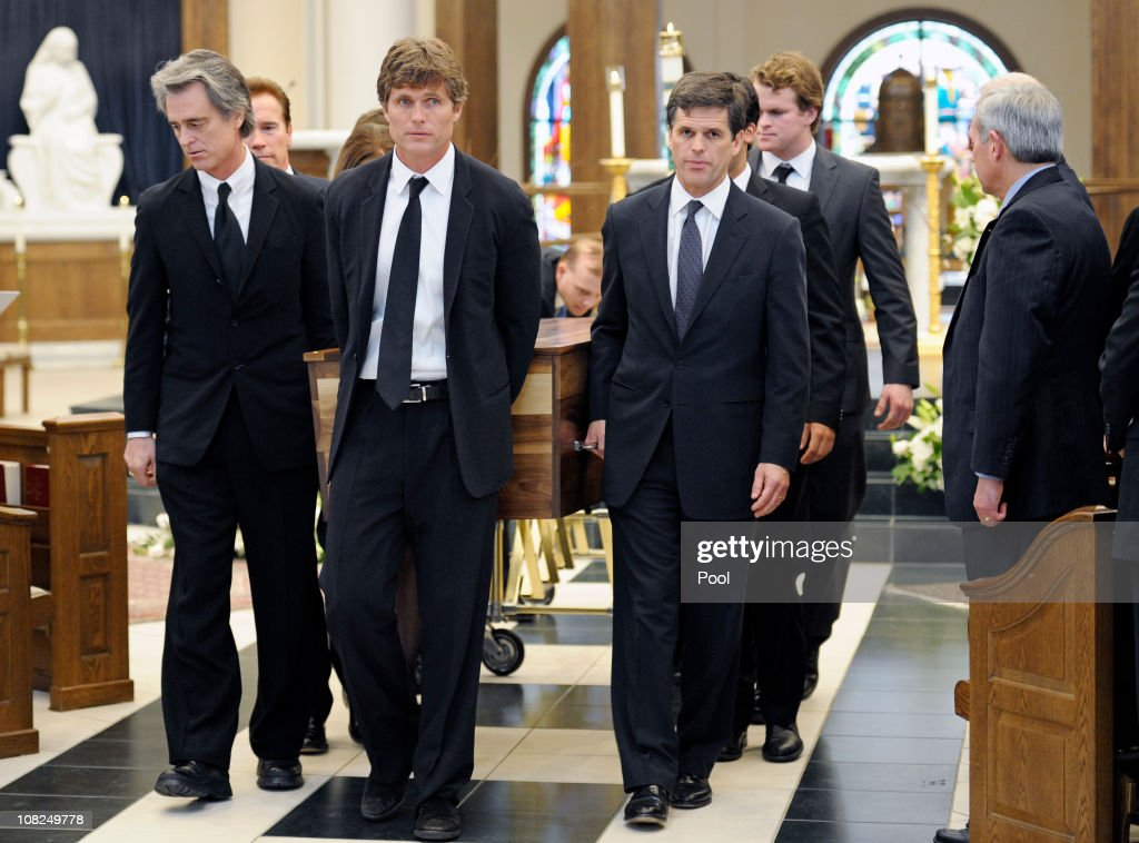 Robert 'Bobby' Shriver III (L), <a gi-track='captionPersonalityLinkClicked' href=/galleries/search?phrase=Anthony+Shriver&family=editorial&specificpeople=727552 ng-click='$event.stopPropagation()'>Anthony Shriver</a> (C) and <a gi-track='captionPersonalityLinkClicked' href=/galleries/search?phrase=Timothy+Shriver&family=editorial&specificpeople=757215 ng-click='$event.stopPropagation()'>Timothy Shriver</a> R() lead the pall bearers as they carry their father's casket out following the funeral service for Sargent Shriver at Our Lady of Mercy Catholic Church January 22, 2011 in Potomac, Maryland. Robert Sargent Shriver Jr., a politician and activist who was the first leader of the Peace Corps and was involved in other social programs, died this week at the age of 95.