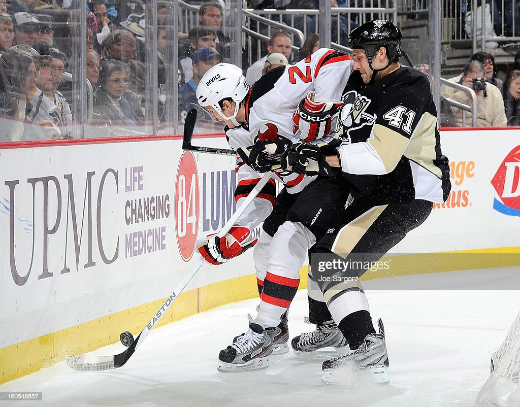 Robert Bortuzzo #41 of the Pittsburgh Penguins battles for the loose puck against David Clarkson #23 of the New Jersey Devils on February 2, 2013 at Consol Energy Center in Pittsburgh, Pennsylvania. Pittsburgh won the game 5-1.