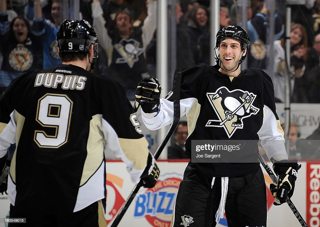 Robert Bortuzzo #41 of the Pittsburgh Penguins celebrates his first NHL goal with <a gi-track='captionPersonalityLinkClicked' href=/galleries/search?phrase=Pascal+Dupuis&family=editorial&specificpeople=208971 ng-click='$event.stopPropagation()'>Pascal Dupuis</a> #9 during the game against the New Jersey Devils on February 2, 2013 at Consol Energy Center in Pittsburgh, Pennsylvania. Pittsburgh won the game 5-1.