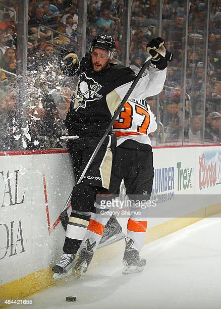 Robert Bortuzzo of the Pittsburgh Penguins collides with Jay Rosehill of the Philadelphia Flyers on April 12 2014 at Consol Energy Center in...
