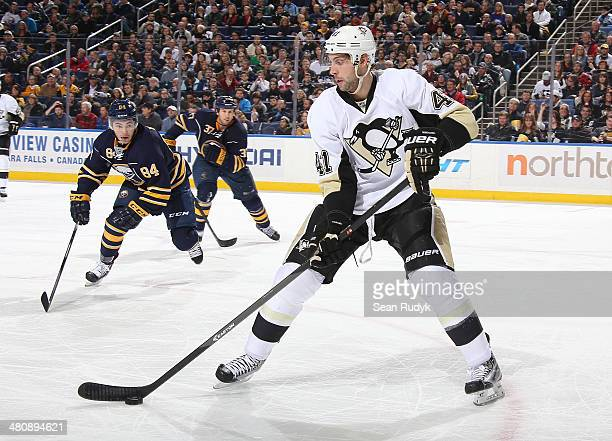Robert Bortuzzo of the Pittsburgh Penguins controls the puck in front of Philip Varone of the Buffalo Sabres at First Niagara Center on February 5...