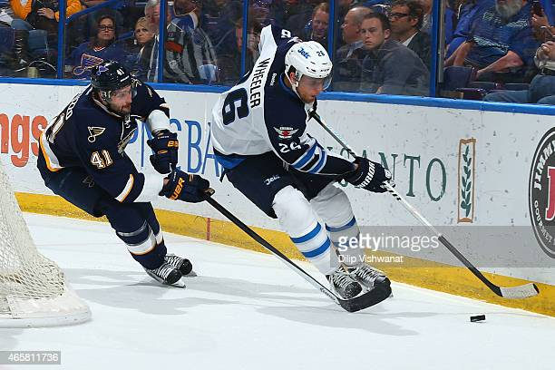 Robert Bortuzzo of the St Louis Blues chases down Blake Wheeler of the Winnipeg Jets at the Scottrade Center on March 10 2015 in St Louis Missouri