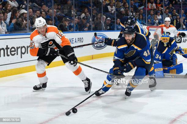 Robert Bortuzzo of the St Louis Blues controls the puck as Jori Lehtera of the Philadelphia Flyers pressures at Scottrade Center on November 2 2017...