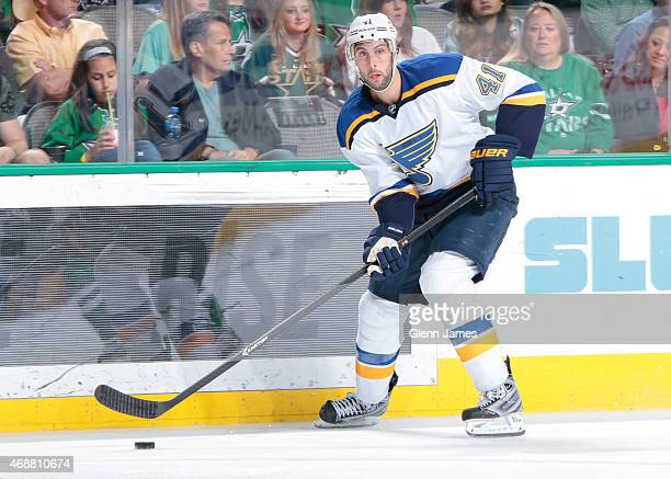 Robert Bortuzzo of the St Louis Blues handles the puck against the Dallas Stars at the American Airlines Center on April 3 2015 in Dallas Texas