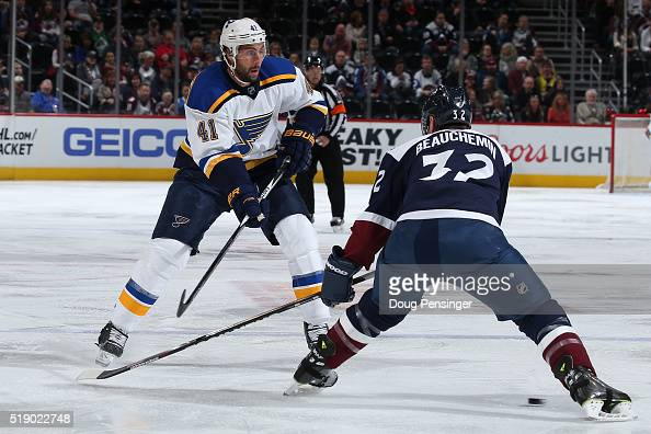Robert Bortuzzo of the St Louis Blues passes the puck past Francois Beauchemin of the Colorado Avalanche at Pepsi Center on April 3 2016 in Denver...