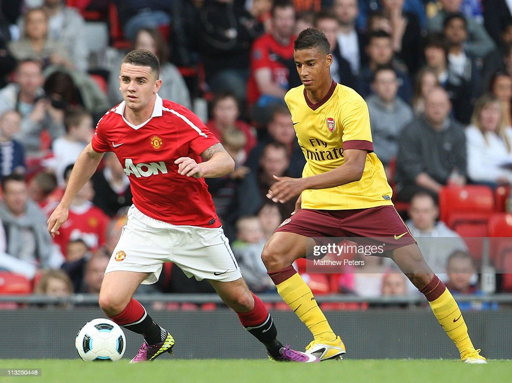 Robert Brady of Manchester United Reserves clashes with Jeremie Aliadiere of Arsenal Reserves during the Barclays Premier Reserve League match between Manchester United Reserves and Arsenal Reserves at Old Trafford on April 28, 2011 in Manchester, England.