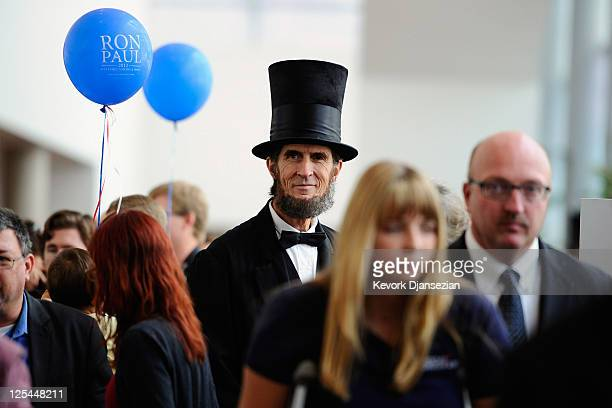 Robert Broski an Abraham Lincoln impersonator walks around during the California Republican Party Convention puts her fingerprint on her ballot as...