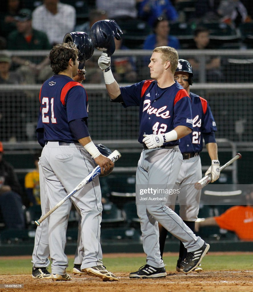 <a gi-track='captionPersonalityLinkClicked' href=/galleries/search?phrase=Robert+Buckley&family=editorial&specificpeople=981297 ng-click='$event.stopPropagation()'>Robert Buckley</a> #42 of the Florida Atlantic Owls is congratulated after hitting a three run home run against the Miami Hurricanes in the sixth inning on March 27, 2013 at Alex Rodriguez Park at Mark Light Field in Coral Gables, Florida. Florida Atlantic defeated Miami 6-1.