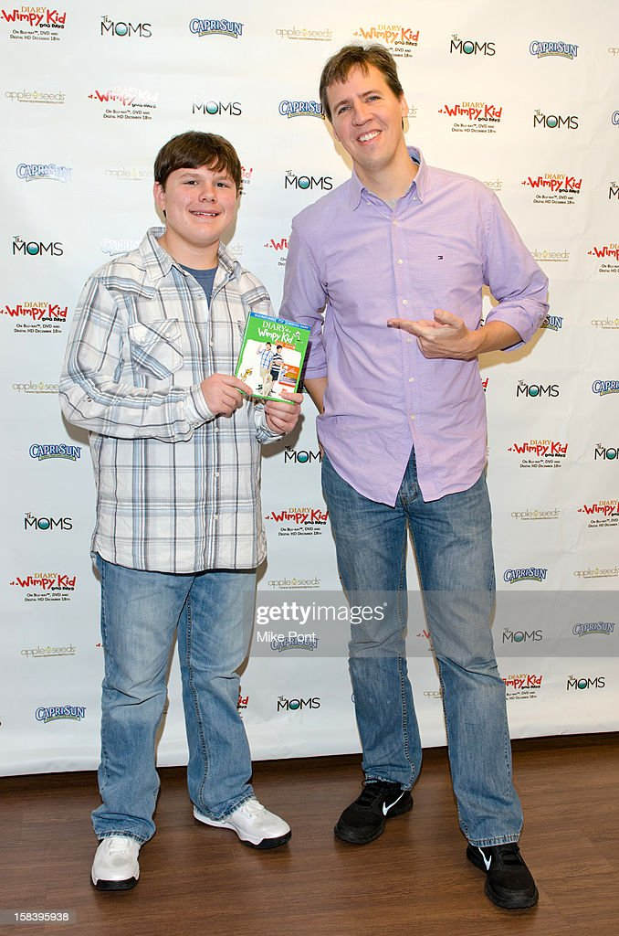 Robert Capron and Author Jeff Kinny attend 'Diary Of A Wimpy Kid: Dog Days' DVD Release Launch Event at apple seeds on December 15, 2012 in New York City.