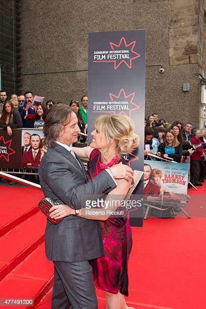 Robert Carlyle hugs Ashley Jensen on the red carpet of the Opening Night Gala and World Premiere of 'The Legend of Barney Thomson' during the...