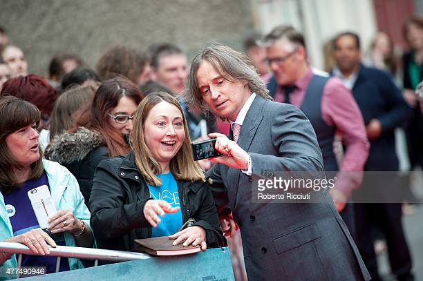 Robert Carlyle makes a selfie with a fan at the Opening Night Gala and World Premiere of 'The Legend of Barney Thomson' at Festival Theatre during...