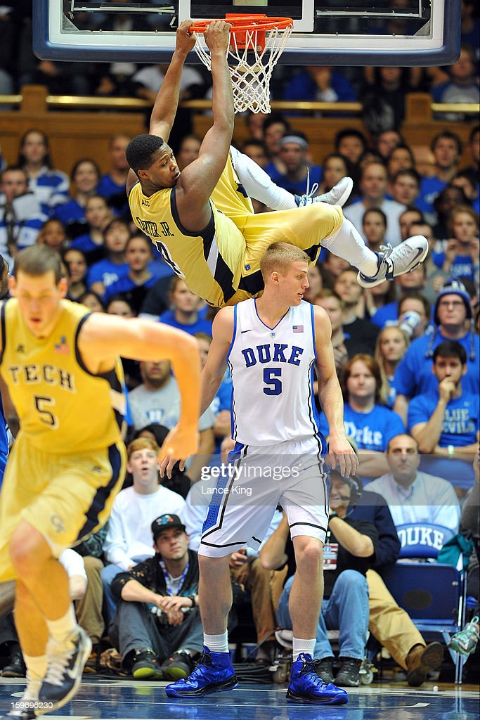 Robert Carter, Jr. #4 of the Georgia Tech Yellow Jackets hangs from the rim following a dunk against Mason Plumlee #5 of the Duke Blue Devils at Cameron Indoor Stadium on January 17, 2013 in Durham, North Carolina. Duke defeated Georgia Tech 73-57.