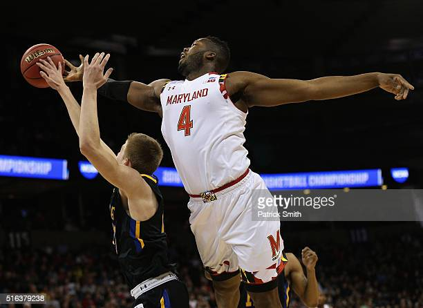 Robert Carter of the Maryland Terrapins blocks the shot of Reed Tellinghuisen of the South Dakota State Jackrabbits in the first half during the...