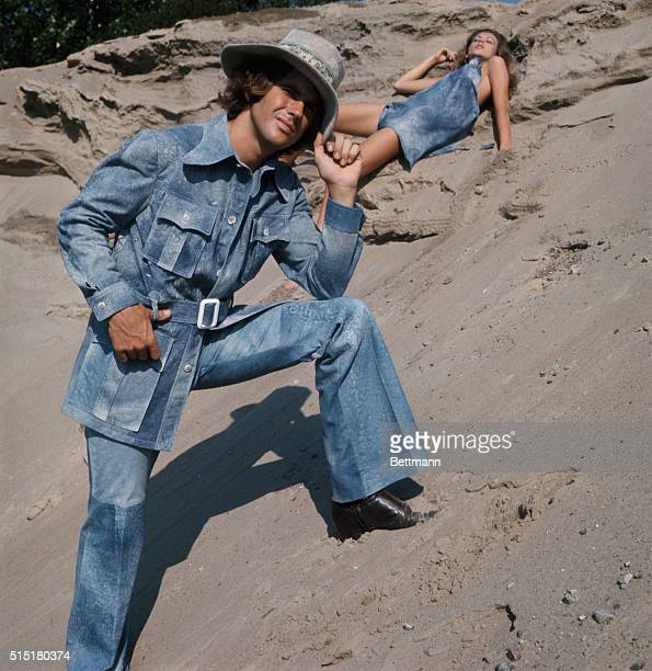 Robert Chernin uses a bleached blue denim look for a safari style jacket and matching pants accessorized with a full belt four flapped pockets and...