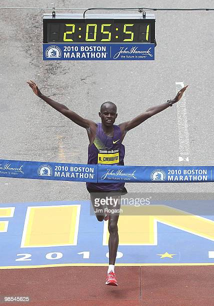 Robert Cheruiyot reacts before he crosses the finish line to win the men's division of the 114th Boston Marathon on April 19 2010 in Boston...