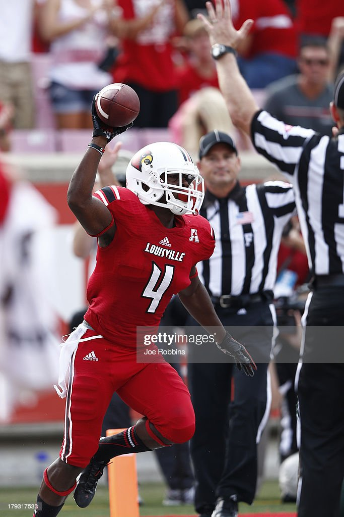 Robert Clark #4 of the Louisville Cardinals celebrates after catching a 25-yard touchdown pass in the third quarter of the game against the Ohio Bobcats at Papa John's Cardinal Stadium on September 1, 2013 in Louisville, Kentucky. Louisville won 49-7.