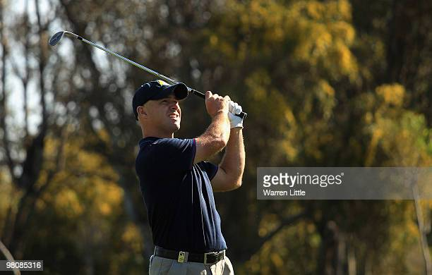 Robert Coles of England plays his second shot into the 17th green during the third round of the Open de Andalucia 2010 at Parador de Malaga Golf on...