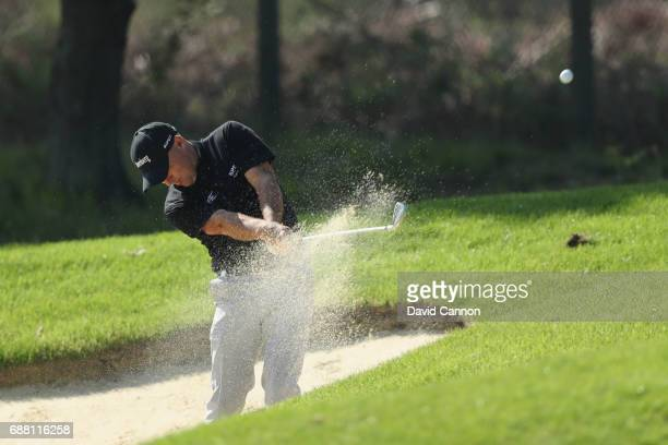 Robert Coles of England plays out of a bunker on the ninth hole during day one of the BMW PGA Championship at Wentworth on May 25 2017 in Virginia...