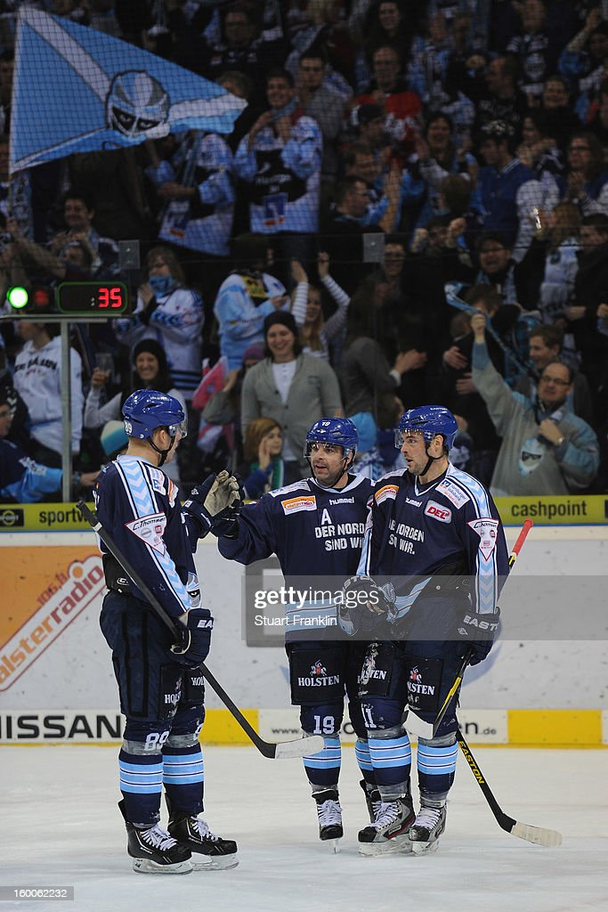 Robert Collins of Hamburg celebrates scoring the winning goal with Colin Murphy during the DEL game between Hamburg Freezers and Thomas Sabo Ice Tigers at O2 World on January 25, 2013 in Hamburg, Germany.