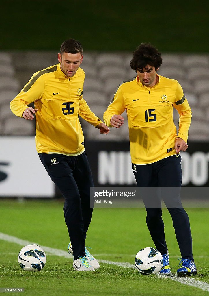 Robert Cornthwaite (L) and <a gi-track='captionPersonalityLinkClicked' href=/galleries/search?phrase=Mile+Jedinak&family=editorial&specificpeople=3123629 ng-click='$event.stopPropagation()'>Mile Jedinak</a> (R) control the ball during an Australian Socceroos training session at WIN Jubilee Stadium on June 13, 2013 in Sydney, Australia.