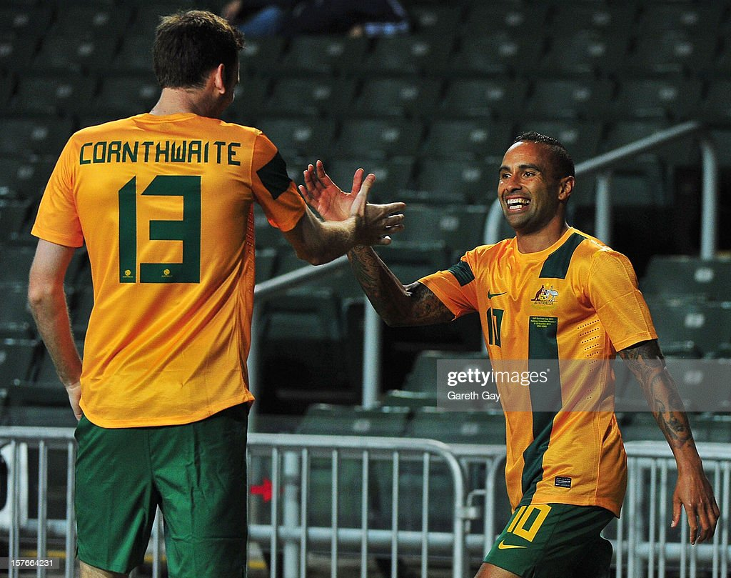 Robert Cornthwaite #13 of Australia celebrates with team-mate #10 <a gi-track='captionPersonalityLinkClicked' href=/galleries/search?phrase=Archie+Thompson&family=editorial&specificpeople=545649 ng-click='$event.stopPropagation()'>Archie Thompson</a> during the 2013 EAFF East Asian Cup Qualifying match between Korea DPR and Australia at Hong Kong Stadium on December 5, 2012 in So Kon Po, Hong Kong.