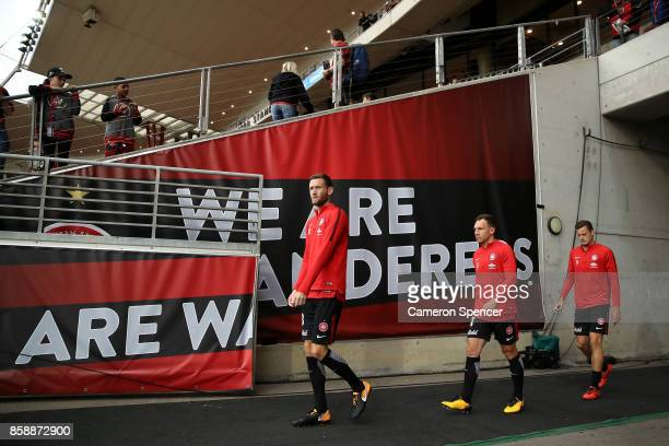 Robert Cornthwaite of the Wanderers and his team walk onto the field during the round one ALeague match between the Western Sydney Wanderers and the...