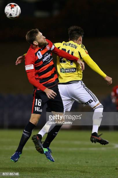 Robert Cornthwaite of the Wanderers and Logan Rogerson of the Phoenix compete for the ball during the FFA Cup round of 32 match between the Western...