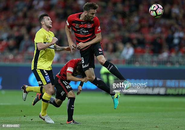 Robert Cornthwaite of the Wanderers heads the ball during the round four ALeague match between the Western Sydney Wanderers and the Central Coast...