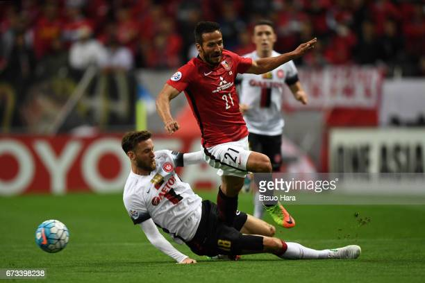 Robert Cornthwaite of Western Sydney and Zlatan Ljubijankic of Urawa Red Diamonds compete for the ball during the AFC Champions League Group F match...