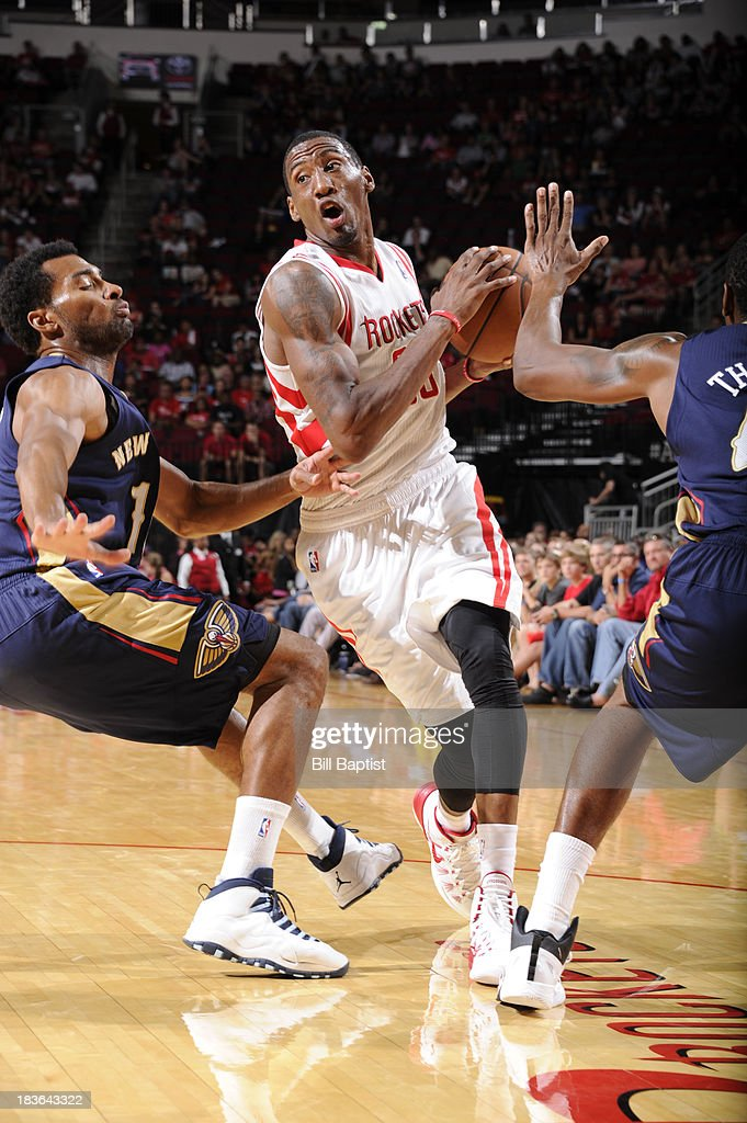 Robert Covington #33 of the Houston Rockets drives the ball against the New Orleans Pelicans during the 2013 NBA pre-season game on October 5, 2013 at the Toyota Center in Houston, Texas.