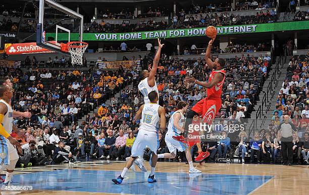 Robert Covington of the Houston Rockets goes up for the shot against the Denver Nuggets on April 9 2014 at the Pepsi Center in Denver Colorado NOTE...