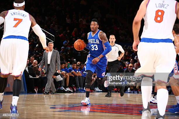 Robert Covington of the Philadelphia 76ers brings the ball up court against the New York Knicks on October 12 2015 at Madison Square Garden in New...