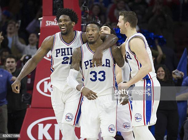 Robert Covington of the Philadelphia 76ers celebrates with Joel Embiid Dario Saric and Nik Stauskas after making the game winning shot in the final...
