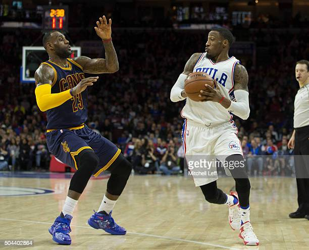 Robert Covington of the Philadelphia 76ers controls the ball against LeBron James of the Cleveland Cavaliers on January 10 2016 at the Wells Fargo...