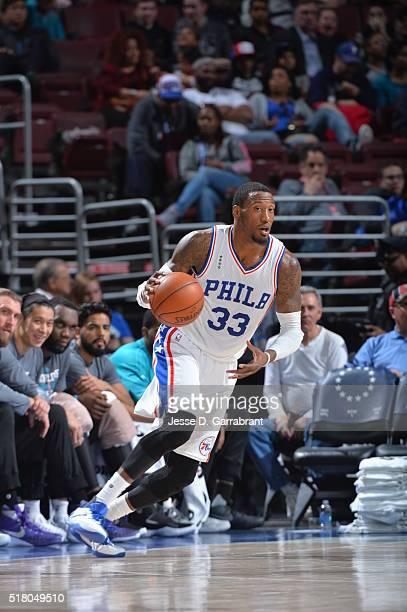 Robert Covington of the Philadelphia 76ers dribbles the ball against the Charlotte Hornets at Wells Fargo Center on March 29 2016 in Philadelphia...