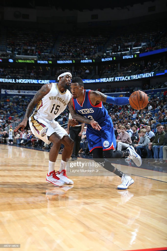 Robert Covington of the Philadelphia 76ers drives against John Salmons of the New Orleans Pelicans on January 26 2015 at Smoothie King Center in New...
