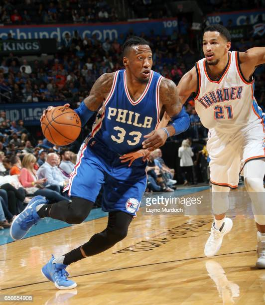 Robert Covington of the Philadelphia 76ers drives to the basket against Andre Roberson of the Oklahoma City Thunder during the game on March 22 2017...