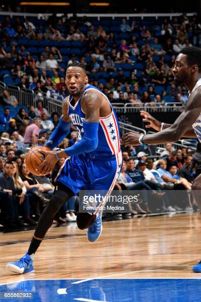Robert Covington of the Philadelphia 76ers drives to the basket against the Orlando Magic during the game on March 20 2017 at Amway Center in Orlando...