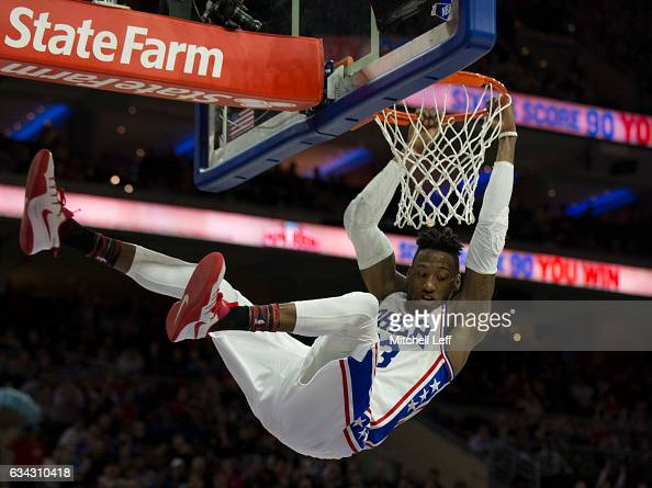 Robert Covington of the Philadelphia 76ers dunks the ball against the San Antonio Spurs in the third quarter at the Wells Fargo Center on February 8...