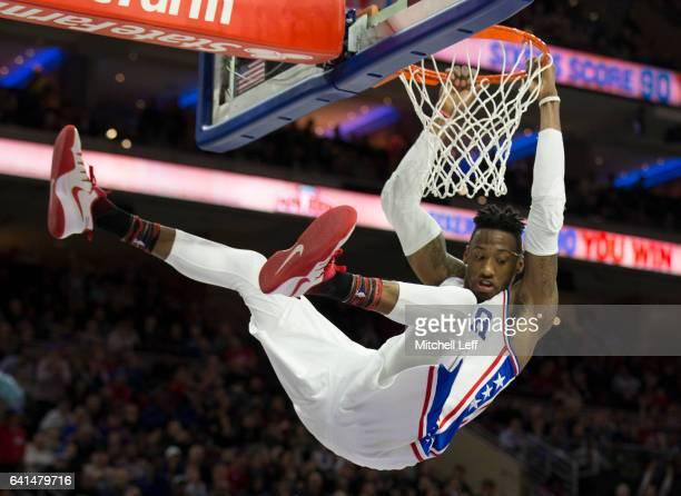 Robert Covington of the Philadelphia 76ers dunks the ball against the San Antonio Spurs at the Wells Fargo Center on February 8 2017 in Philadelphia...
