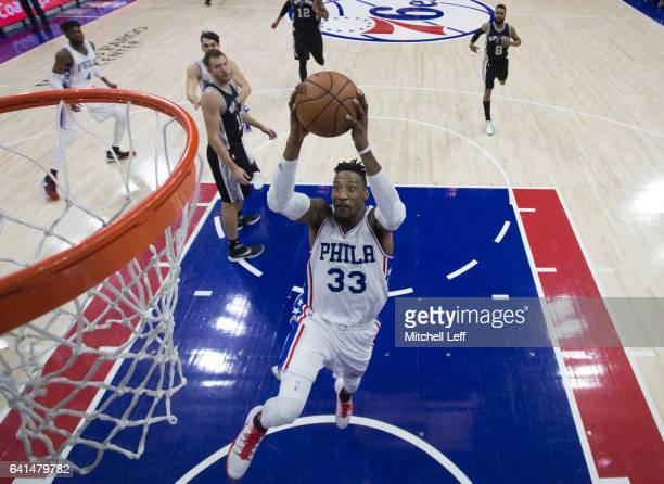 Robert Covington of the Philadelphia 76ers dunks the ball against the San Antonio Spurs in the third quarter at the Wells Fargo Center on February 8...