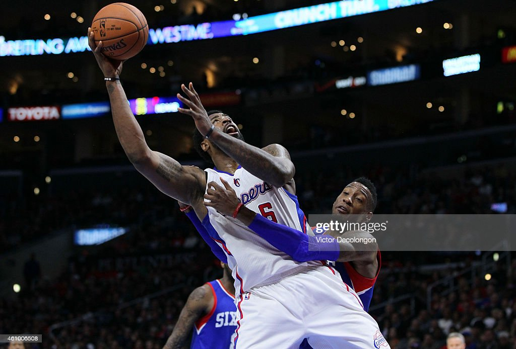 <a gi-track='captionPersonalityLinkClicked' href=/galleries/search?phrase=Robert+Covington&family=editorial&specificpeople=8607800 ng-click='$event.stopPropagation()'>Robert Covington</a> #33 of the Philadelphia 76ers fouls <a gi-track='captionPersonalityLinkClicked' href=/galleries/search?phrase=DeAndre+Jordan&family=editorial&specificpeople=4665718 ng-click='$event.stopPropagation()'>DeAndre Jordan</a> #6 of the Los Angeles Clippers while Jordan is shooting in the second half during the NBA game at Staples Center on January 3, 2015 in Los Angeles, California. Jordan scored on the play and the basket counted. The Clippers defeated the Sixers 127-91.NOTE