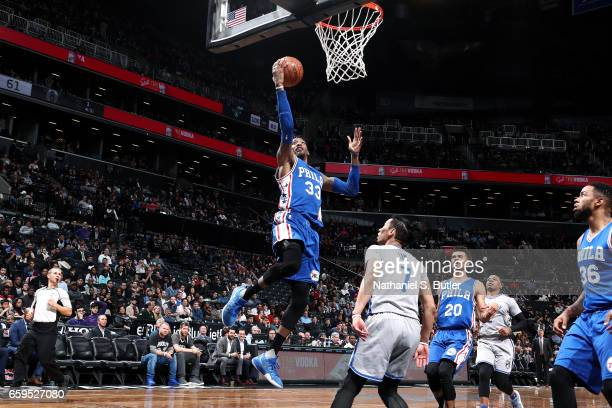 Robert Covington of the Philadelphia 76ers goes for a lay up during the game against the Brooklyn Nets on March 28 2017 at Barclays Center in...