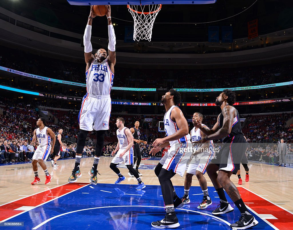 <a gi-track='captionPersonalityLinkClicked' href=/galleries/search?phrase=Robert+Covington&family=editorial&specificpeople=8607800 ng-click='$event.stopPropagation()'>Robert Covington</a> #33 of the Philadelphia 76ers grabs the rebound against the Los Angeles Clippers at Wells Fargo Center on February 8, 2016 in Philadelphia, Pennsylvania