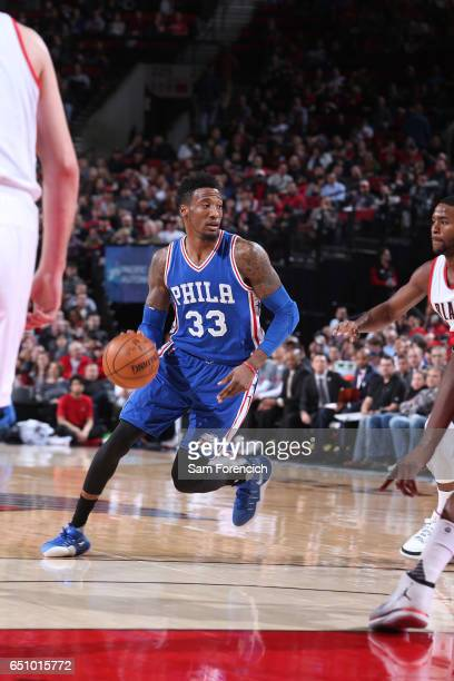 Robert Covington of the Philadelphia 76ers handles the ball against the Portland Trail Blazers during the game on March 9 2017 at the Moda Center in...