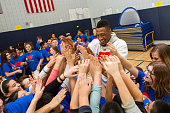 Robert Covington of the Philadelphia 76ers participates in NBA Cares/FIT Day of Service at West PS 087 Middle Village during the 2015 NBA AllStar on...