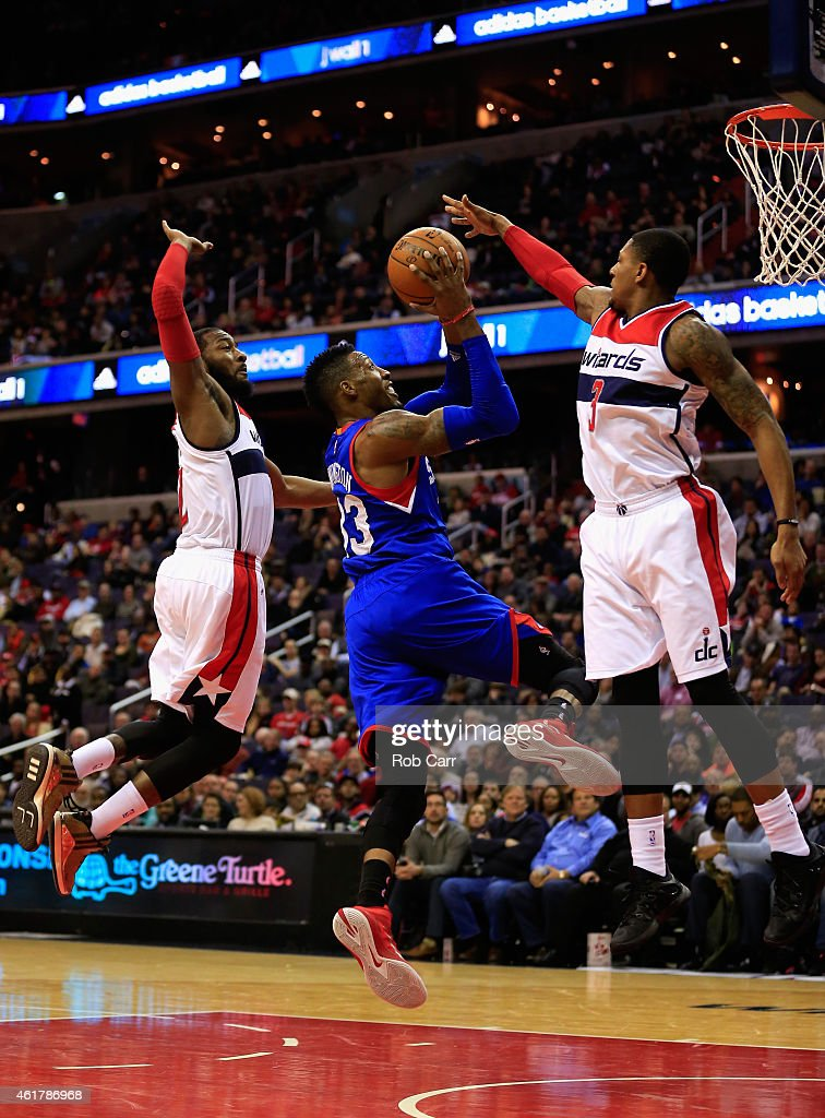 Robert Covington #33 of the Philadelphia 76ers puts up a shot in front of <a gi-track='captionPersonalityLinkClicked' href=/galleries/search?phrase=John+Wall&family=editorial&specificpeople=2265812 ng-click='$event.stopPropagation()'>John Wall</a> #2 and <a gi-track='captionPersonalityLinkClicked' href=/galleries/search?phrase=Bradley+Beal&family=editorial&specificpeople=7640439 ng-click='$event.stopPropagation()'>Bradley Beal</a> #3 of the Washington Wizards during the first half at Verizon Center on January 19, 2015 in Washington, DC.