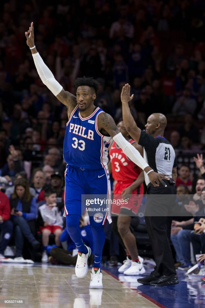 Robert Covington #33 of the Philadelphia 76ers reacts after a made three point basket in front of OG Anunoby #3 of the Toronto Raptors in the third quarter at the Wells Fargo Center on January 15, 2018 in Philadelphia, Pennsylvania. The 76ers defeated the Raptors 117-111.