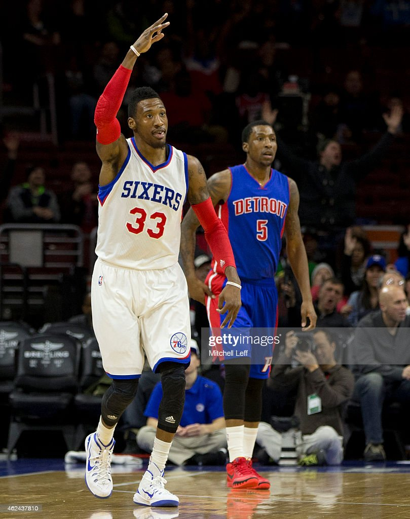 <a gi-track='captionPersonalityLinkClicked' href=/galleries/search?phrase=Robert+Covington&family=editorial&specificpeople=8607800 ng-click='$event.stopPropagation()'>Robert Covington</a> #33 of the Philadelphia 76ers reacts after making a three point basket with <a gi-track='captionPersonalityLinkClicked' href=/galleries/search?phrase=Kentavious+Caldwell-Pope&family=editorial&specificpeople=7621166 ng-click='$event.stopPropagation()'>Kentavious Caldwell-Pope</a> #5 of the Detroit Pistons defending on the play on January 28, 2015 at the Wells Fargo in Philadelphia, Pennsylvania. The 76ers defeated the Pistons 89-69.